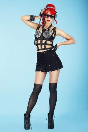 Glam. Full  Length of Stylish Fashion Model in Dark Eyewear and Trendy Clothes photo