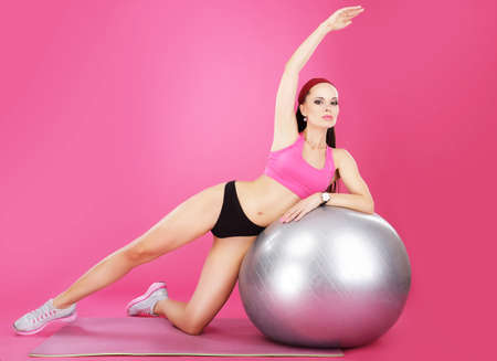fit ball: Aerobics. Sporty Woman on Fitness Ball Exercising