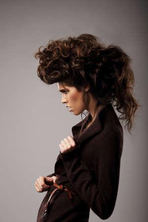 shaggy: Charisma. Stylish Woman with Unusual Shaggy Hairstyle