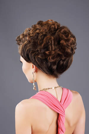 frizzy: Frizzy Hair. Rear View of Brown Hair Woman with Festive Hairstyle