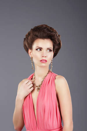 upsweep: Stylish Lady in Pink Dress with Ornamentation