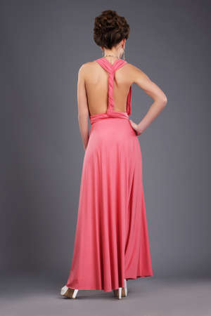 Rear View of Shapely Lady in Evening Gown