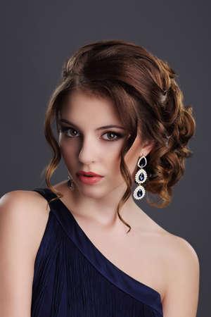 auburn: Elegance. Stylish Lady with Precious Gem - Platinum Eardrops with Jewels Stock Photo