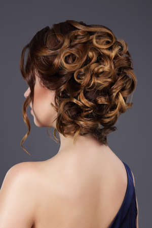 occiput: Rear View of Womans Festive Hairstyle. Waved Hairs