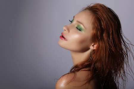 Imagination. Redhead Woman with Wet Hair Dreaming photo
