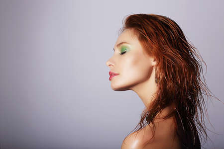 wet lips: Profile of Seductive Redhead Woman with Wet Hair