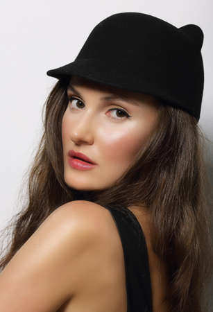 kepi: Portrait of Young Woman in Dark Hat