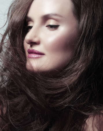 Pretty Woman Brunette with Blowing Healthy Hair photo