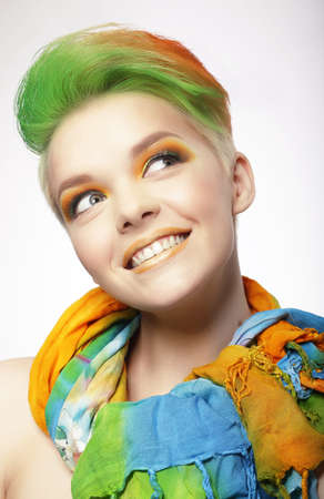 Funny Smiling Woman with Colored Hairs Looking Up photo
