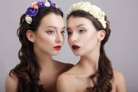 Inspiration.Two Styled Females with Wreaths of Flowers photo