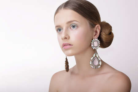 platinum hair: Luxury. Sophisticated Woman with Pearly Earrings with Diamonds