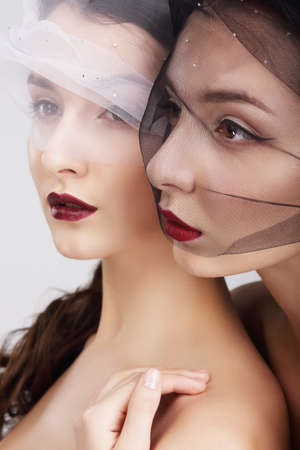 Fondness. Two Females in Veils Embracing photo