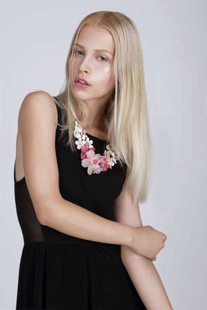 Exquisite Blond Woman with Flowery Necklace photo