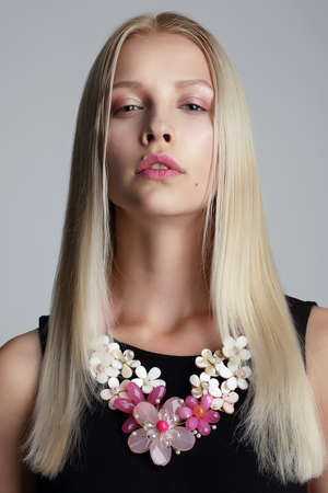 Long Hair Blonde with Vernal Garland on her Neck photo