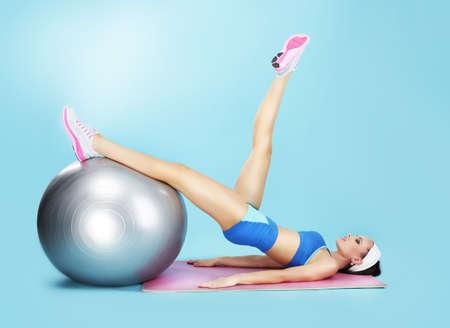 pilates ball: Aerobics. Sportswoman in Sport Club with Fitness Ball Stock Photo
