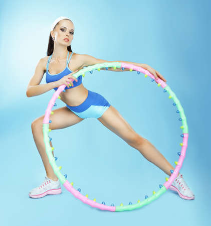 flexion: Gymnastics. Fit Woman with Hoop in Fitness Club