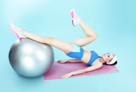 pilates ball: Workout. Active Woman exercising with Fitness Ball Stock Photo