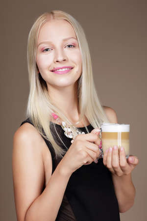 Pleasure. Woman Blonde holding Cup of Morning Cofee photo