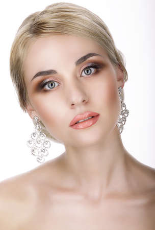 magnetism: Magnetism. Portrait of Young Blond with Glossy Earrings Stock Photo