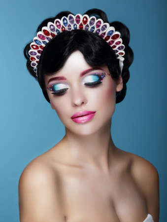 glam rock: Luxurious Dreamy Female with Bright Makeup and Art Diadem Stock Photo