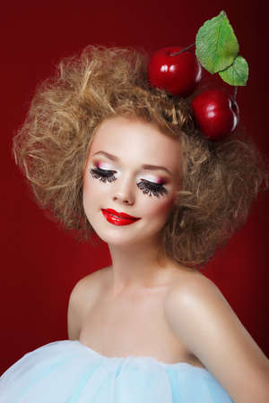 circus stage: Grotesque. Humorous Woman with Red Apples and Fancy Makeup