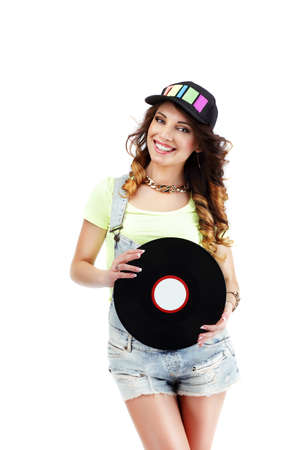 kepi: Young Musician in Baseball Hat with Retro Vinyl DIsc Stock Photo