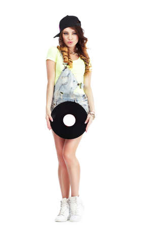 kepi: Full  Length Portrait of Woman in Kepi and Jeans with Vinyl Record