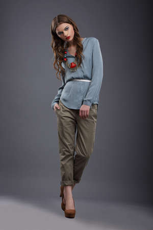 pretentious: Studio Shot of Trendy Fashion Model in Pants and Blouse Stock Photo