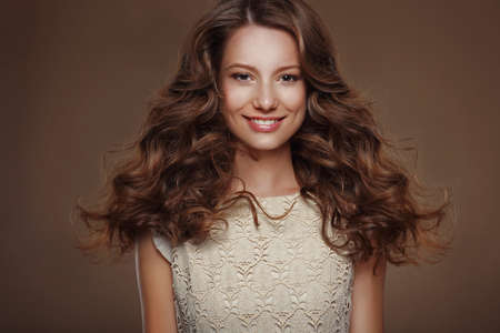 auburn hair: Beautiful Happy Brunette with Long Curly Hairs