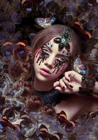 Inspiration. Woman with Fantastic Teardrops and Butterflies photo