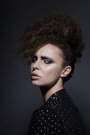 whim of fashion: Individuality. Glamorous Brunette with Curly Hair