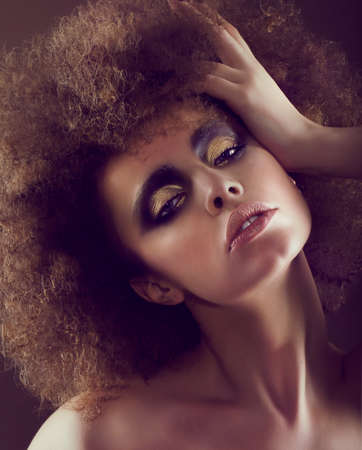 perm: Dreamy Woman with Frizzy Hairstyle and Golden Eyeshadow