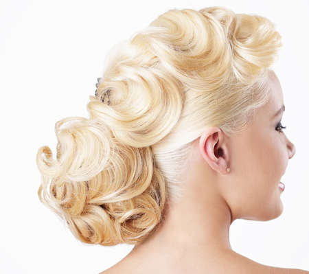 frizzy hair: Elegance. Rear View of Blonde with Festive Hairstyle