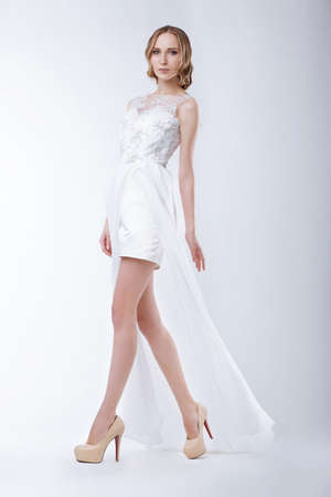 Slender Fashion Model Wearing White Dress photo