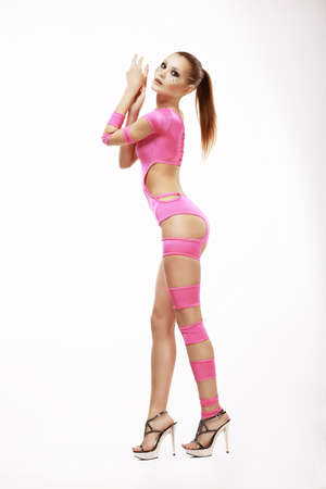 clubbing: Clubbing. Redhead Woman in Pink Stagy Costume Stock Photo