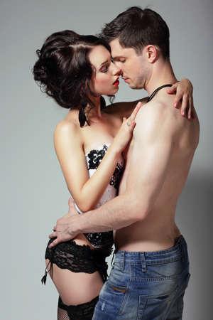 sensuality: Sensuality. Young Couple Hugging