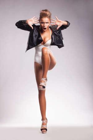 dancing club: Night Club. Eccentric Young Woman Dancing Stock Photo