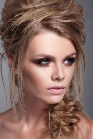 woman hairstyle: Fashionable portrait of a woman close-up. Beauty and fashion. Stock Photo