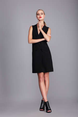 Fashion model in simply black dress.