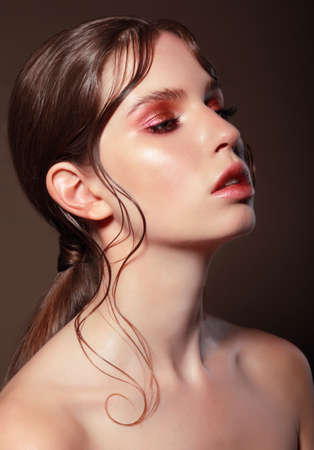 beautiful neck: Fashion portrait of a young woman with bright makeup.