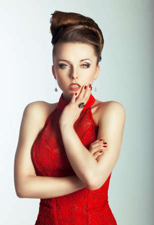 Arrogant woman in a red evening dress. photo