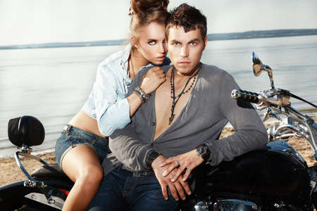 men and women: Attractive young couple on a motorcycle.