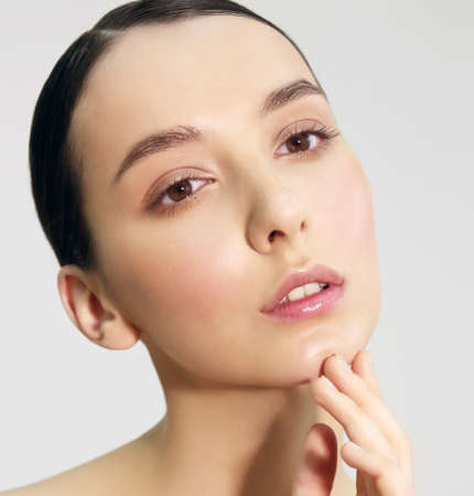 clear skin: Close-up portrait of a young woman. Natural light, natural makeup.