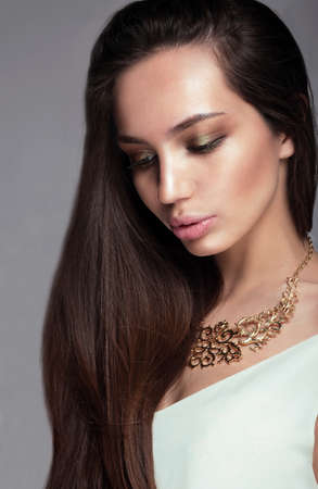 full lips: Glamour portrait of a woman looking down. Long hair, full lips, professional make-up. Stock Photo