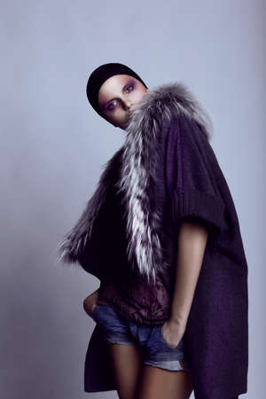 fashion model: Fashion, model. Stylish woman posing in studio, modern clothes.