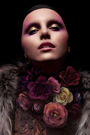 Vogue portrait of a woman. Fashion concept photo. Art installation. Flower. photo