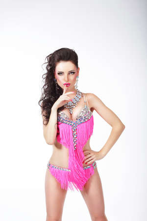 Beautiful woman dancing in a bright suit. Party, disco, dance. photo