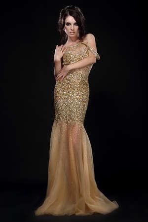 Young beautiful woman in long evening dress. photo