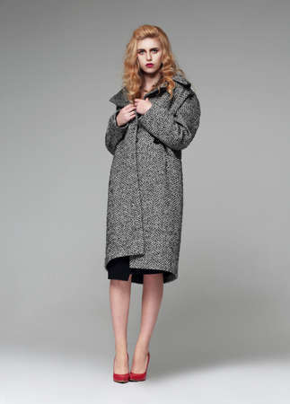 Fashion & Style.Woman in coat. Full height.