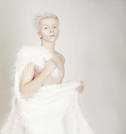 Surreal portrait of a young man. Albino. photo